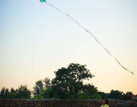 Children playing kites in Paknam Khaem Nu